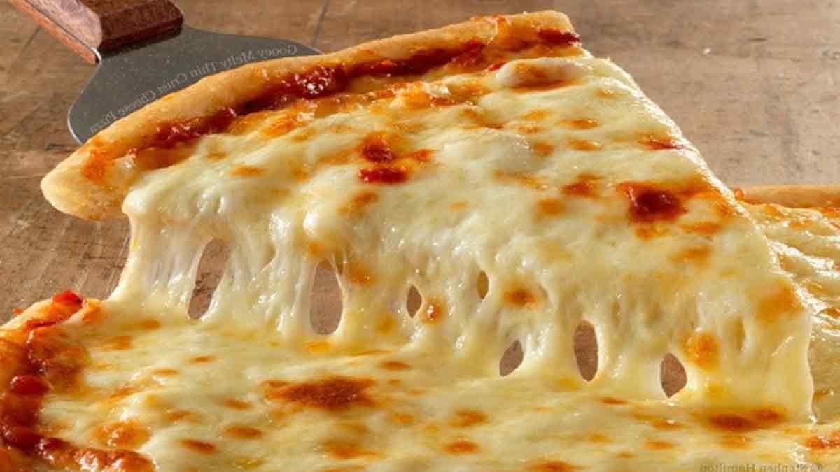 Lyon : La pizza aux 834 fromages bat un nouveau record du monde La-recette-de-pizza-quatre-fromages